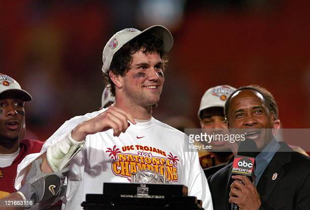 USC quarterback Matt Leinart is interviewed by Lynn Swann of ABC after 5519 victory over Oklahoma in the FedEx Orange Bowl at Pro Player Stadium in...