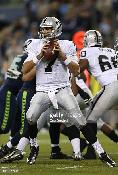 Quarterback Matt Leinart of the Oakland Raiders looks to pass against the Seattle Seahawks at CenturyLink Field on August 30 2012 in Seattle...