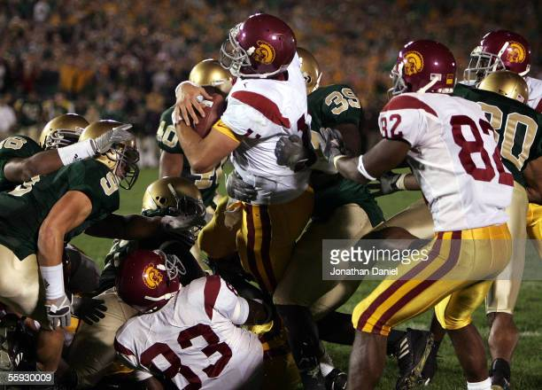 Quarterback Matt Leinart of the University of Southern California Trojans rolls into the end zone with the winning touchdown against the Notre Dame...