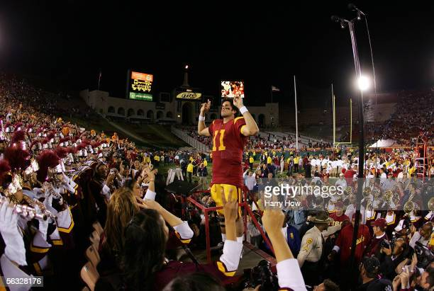 Quarterback Matt Leinart of the USC Trojans leads the USC band following USC's 619 win against the UCLA Bruins December 3 2005 at the Los Angeles...