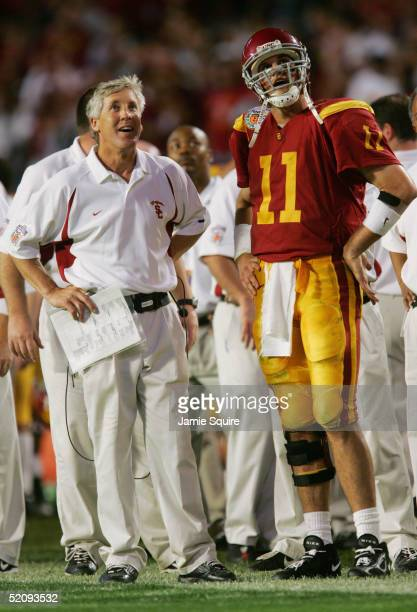 Quarterback Matt Leinart of the USC Trojans looks on with head coach Pete Carroll while facing the Oklahoma Sooners during the FedEx Orange Bowl 2005...
