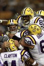 Quarterback Matt Mauck of the LSU Tigers celebrates with the rest of the offense after scoring a touchdown during the Southeastern Conference...