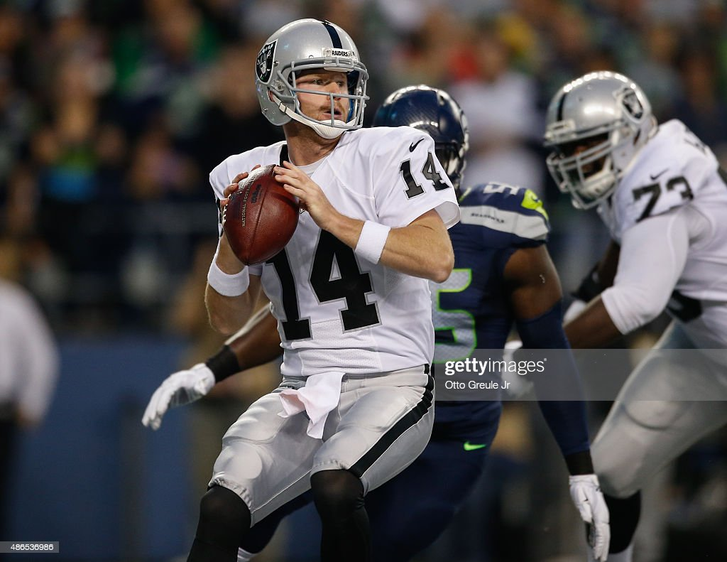 Quarterback <a gi-track='captionPersonalityLinkClicked' href=/galleries/search?phrase=Matt+McGloin&family=editorial&specificpeople=7301322 ng-click='$event.stopPropagation()'>Matt McGloin</a> #14 of the Oakland Raiders looks to pass against the Seattle Seahawks at CenturyLink Field on September 3, 2015 in Seattle, Washington.