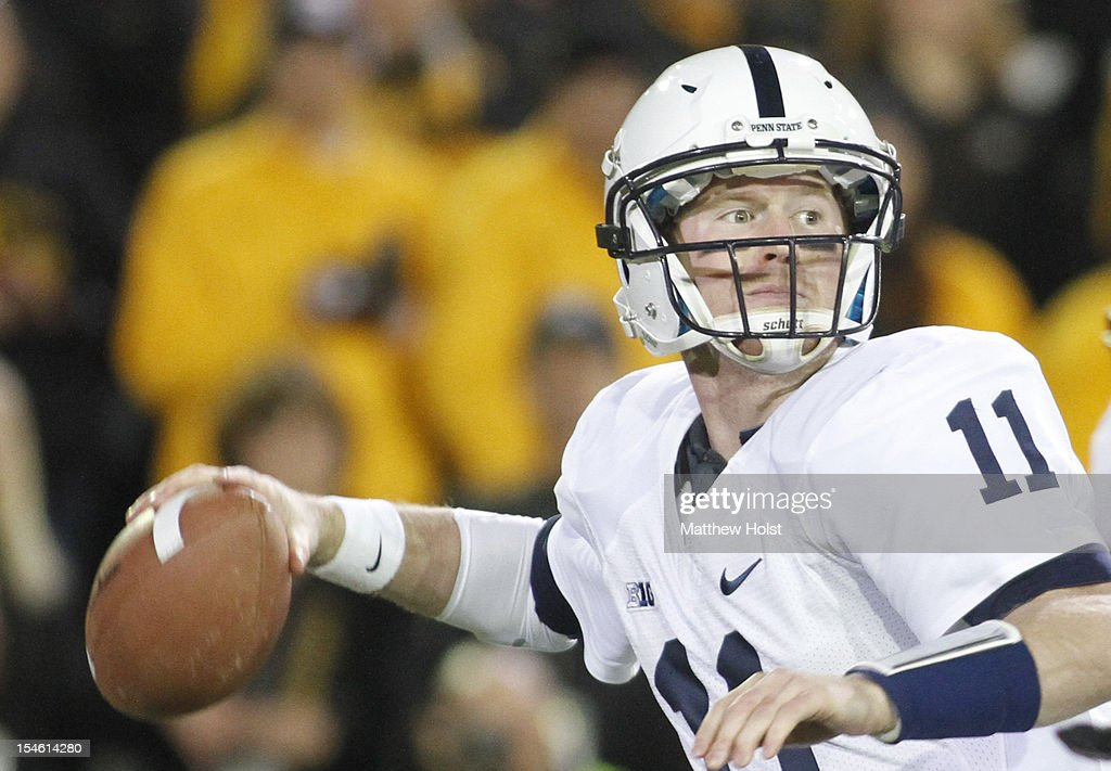 Quarterback <a gi-track='captionPersonalityLinkClicked' href=/galleries/search?phrase=Matt+McGloin&family=editorial&specificpeople=7301322 ng-click='$event.stopPropagation()'>Matt McGloin</a> #11 of the Penn State Nittany Lions drops back to pass during the first quarter against the Iowa Hawkeyes on October 20, 2012 at Kinnick Stadium in Iowa City, Iowa. Penn State defeated Iowa 38-14.