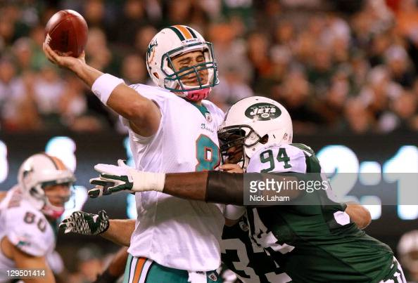 Quarterback Matt Moore of the Miami Dolphins passes against Marcus Dixon of the New York Jets during the third quarter at MetLife Stadium on October...
