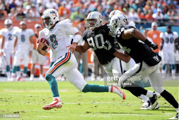 Quarterback Matt Moore of the Miami Dolphins scrambles during a NFL game against the Oakland Raiders at Sun Life Stadium on December 4 2011 in Miami...