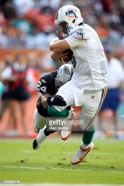 Quarterback Matt Moore of the Miami Dolphins scrambles for a touchdown against the Oakland Raiders at Sun Life Stadium on December 4 2011 in Miami...