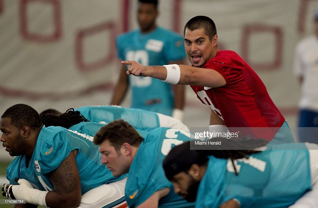 Quarterback Matt Moore, top right, calls pass protection during Miami Dolphins practice at the Dolphins training facility at NSU in Davie, Florida, Tuesday, July 23, 2013.