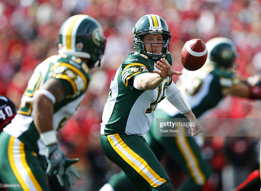 Quarterback Matt Nichols passes the ball to Kendial Lawrence of the Edmonton Eskimos in the first half of their CFL football game against the Calgary Stampeders September 1, 2014 at McMahon Stadium in Calgary, Alberta, Canada.