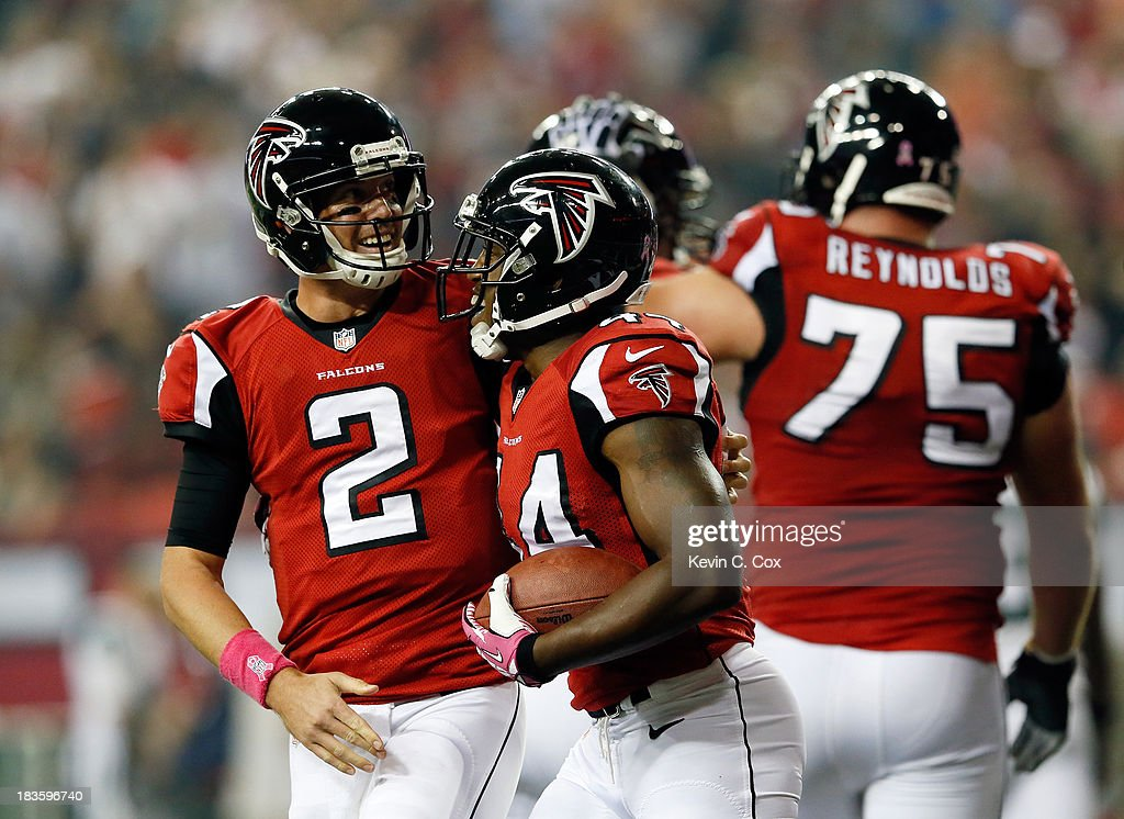 Quarterback Matt Ryan celebrates a touchdown with fullback Jason Snelling of the Atlanta Falcons in the second quarter against the New York Jets...