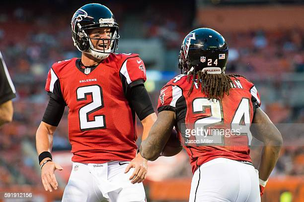 Quarterback Matt Ryan celebrates with running back Devonta Freeman of the Atlanta Falcons after Freeman rushed for a 19 yard touch down during the...