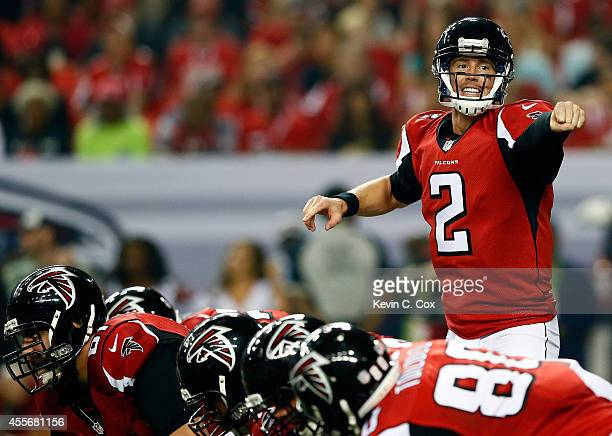 Quarterback Matt Ryan of the Atlanta Falcons calls a play against the Tampa Bay Buccaneers during a game at the Georgia Dome on September 18 2014 in...