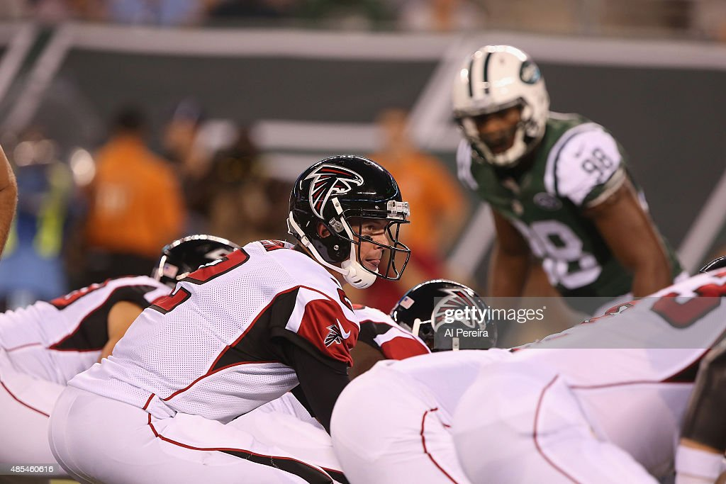 Quarterback <a gi-track='captionPersonalityLinkClicked' href=/galleries/search?phrase=Matt+Ryan+-+American+Football+Player&family=editorial&specificpeople=4951318 ng-click='$event.stopPropagation()'>Matt Ryan</a> #2 of the Atlanta Falcons calls a play against the New York Jets at MetLife Stadium on August 21, 2015 in East Rutherford, New Jersey.