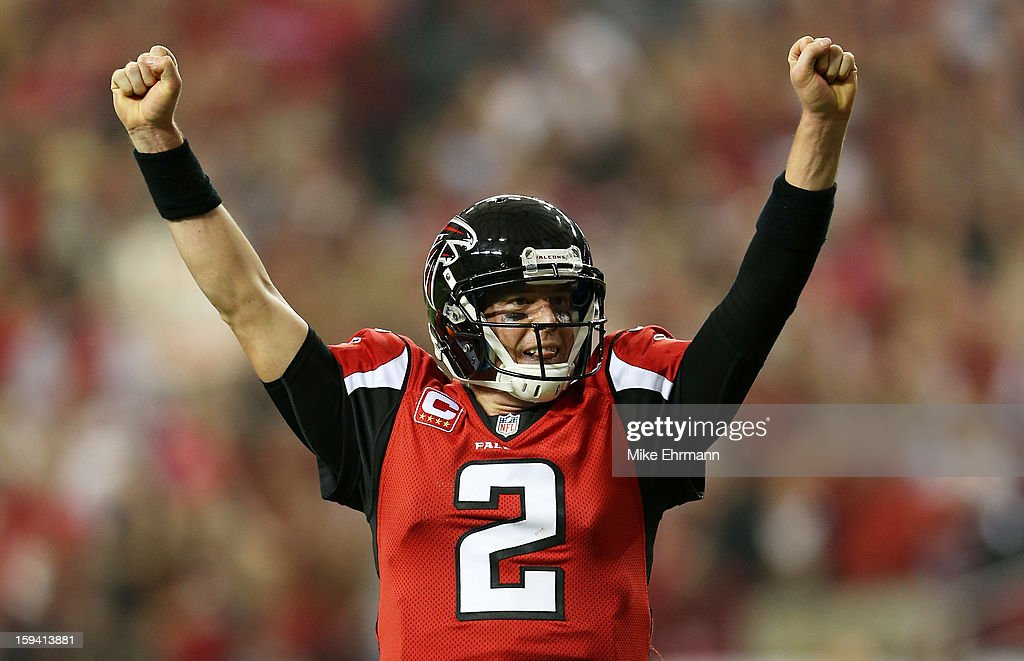 Quarterback Matt Ryan #2 of the Atlanta Falcons celebrates a third quarter touchdown pass against the Seattle Seahawks during the NFC Divisional Playoff Game at Georgia Dome on January 13, 2013 in Atlanta, Georgia.