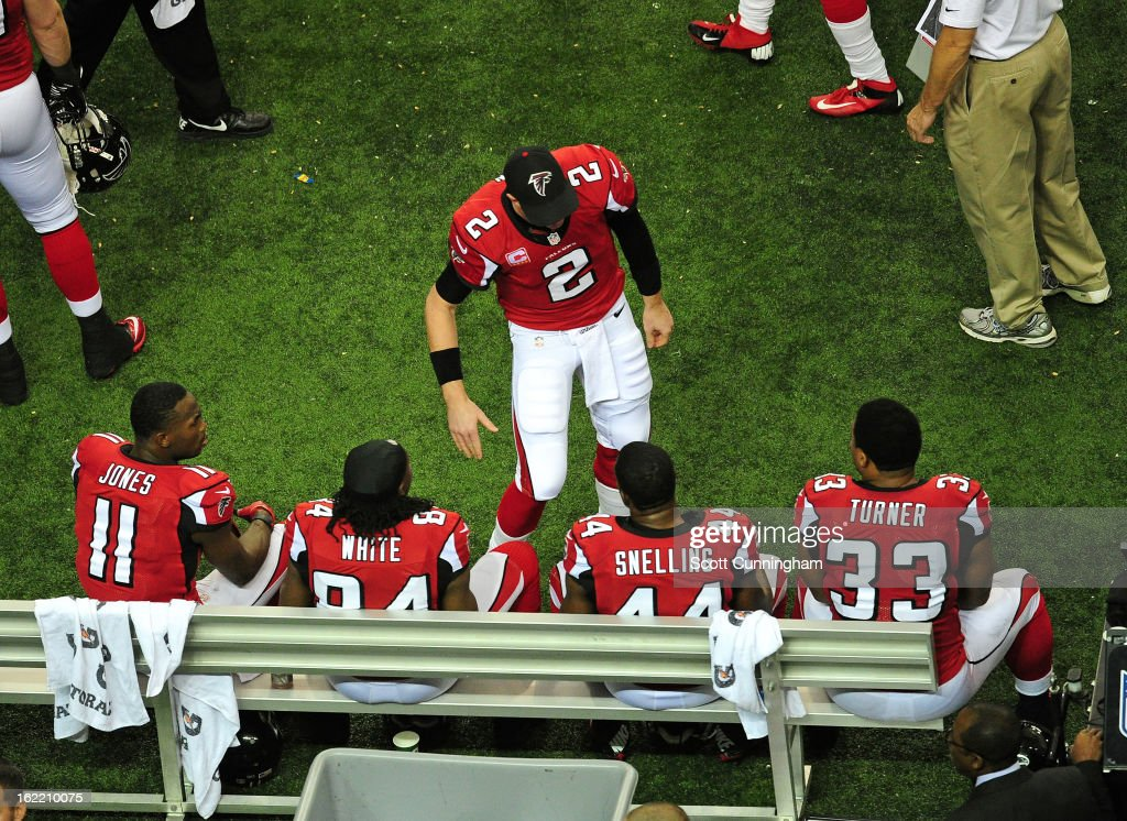 Quarterback Matt Ryan #2 of the Atlanta Falcons celebrates with members of his offense against the San Francisco 49ers during the NFC Championship game at the Georgia Dome on January 20, 2013 in Atlanta, Georgia.