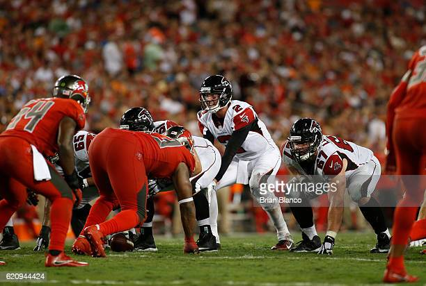 Quarterback Matt Ryan of the Atlanta Falcons controls the offense during the third quarter of an NFL game against the Tampa Bay Buccaneers on...