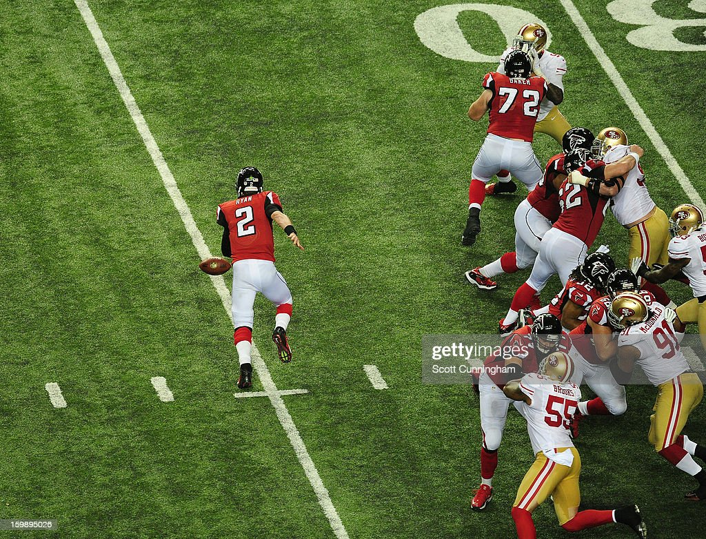 Quarterback Matt Ryan #2 of the Atlanta Falcons fumbles a snap, resulting in a turnover against the San Francisco 49ers during the NFC Championship game at the Georgia Dome on January 20, 2013 in Atlanta, Georgia.