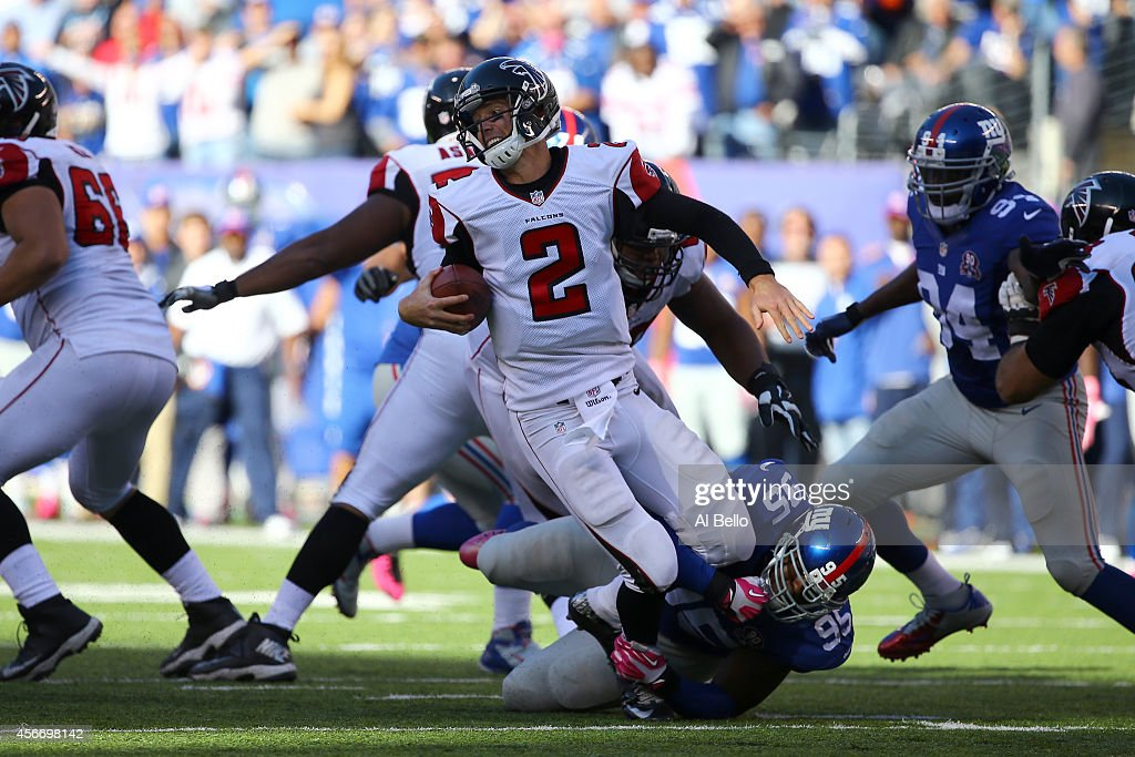 Quarterback Matt Ryan #2 of the Atlanta Falcons gets sacked by defensive tackle Johnathan Hankins #95 of the New York Giants in the fourth quarter of their game at MetLife Stadium on October 5, 2014 in East Rutherford, New Jersey.