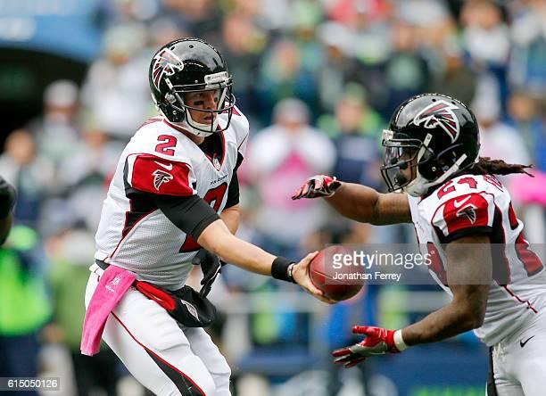 Quarterback Matt Ryan of the Atlanta Falcons hands off to Running back Devonta Freeman against the Seattle Seahawks at CenturyLink Field on October...
