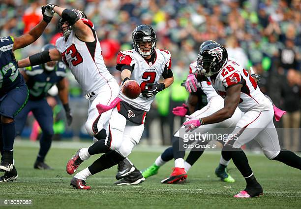 Quarterback Matt Ryan of the Atlanta Falcons hands off to Running back Tevin Coleman against the Seattle Seahawks at CenturyLink Field on October 16...