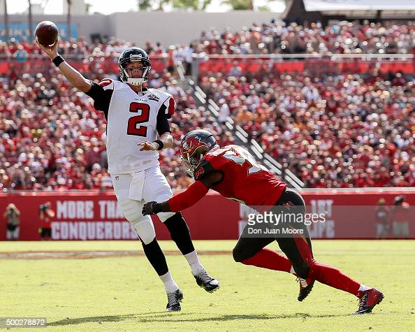 Quarterback Matt Ryan of the Atlanta Falcons is forced out of the pocket by Linebacker Kwon Alexanders during the game against the Tampa Bay...