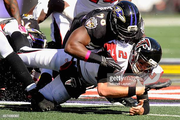 Quarterback Matt Ryan of the Atlanta Falcons is sacked in the second quarter by outside linebacker Elvis Dumervil of the Baltimore Ravens at MT Bank...