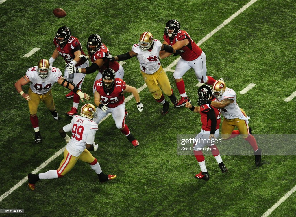 Quarterback Matt Ryan #2 of the Atlanta Falcons passes as he is hit by Ahmad Brooks #55 of the San Francisco 49ers during the NFC Championship game at the Georgia Dome on January 20, 2013 in Atlanta, Georgia.