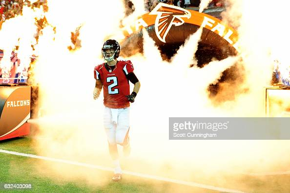 Quarterback Matt Ryan of the Atlanta Falcons runs onto the field to take on the Green Bay Packers in the NFC Championship Game at the Georgia Dome on...