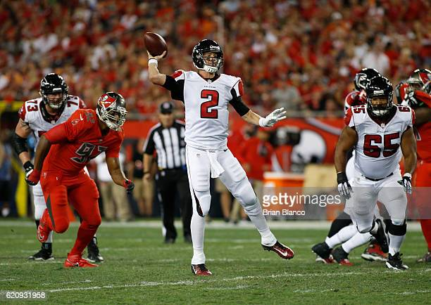 Quarterback Matt Ryan of the Atlanta Falcons throws a 32yard touchdown pass to tight end Levine Toilolo during the first quarter of an NFL game...
