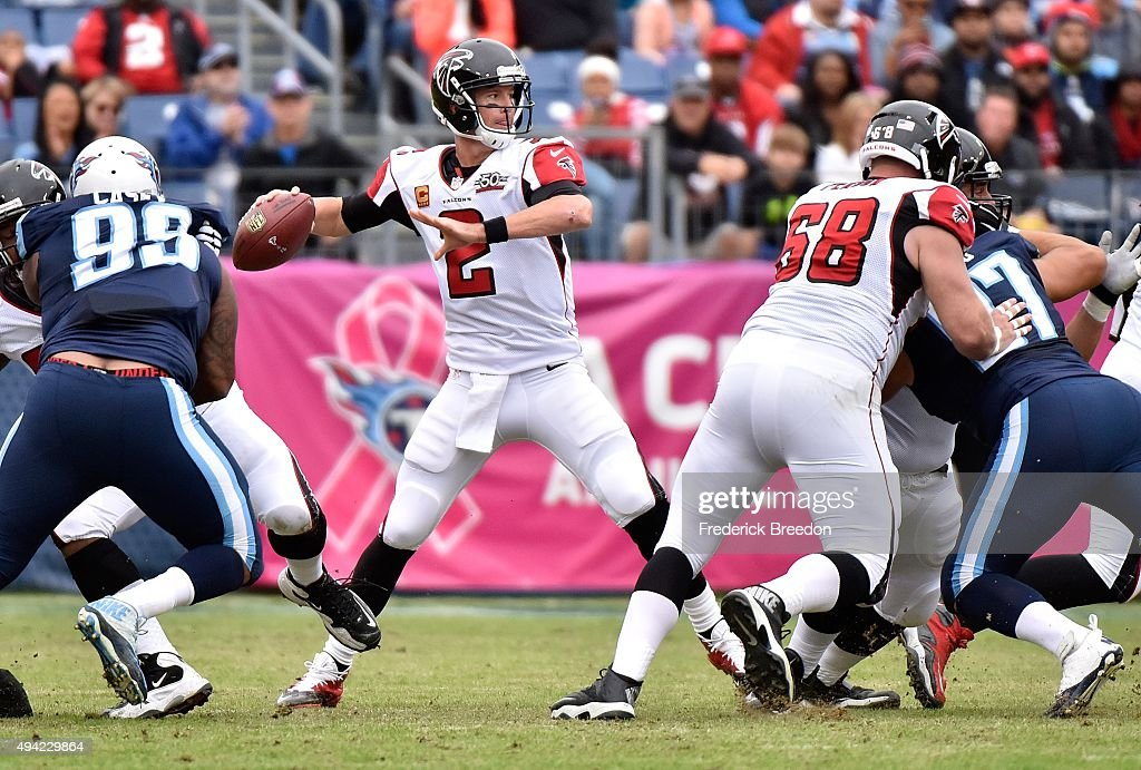 Quarterback <a gi-track='captionPersonalityLinkClicked' href=/galleries/search?phrase=Matt+Ryan+-+American+Football+Player&family=editorial&specificpeople=4951318 ng-click='$event.stopPropagation()'>Matt Ryan</a> #2 of the Atlanta Falcons throws a pass against the Tennessee Titans during the first half at Nissan Stadium on October 25, 2015 in Nashville, Tennessee.