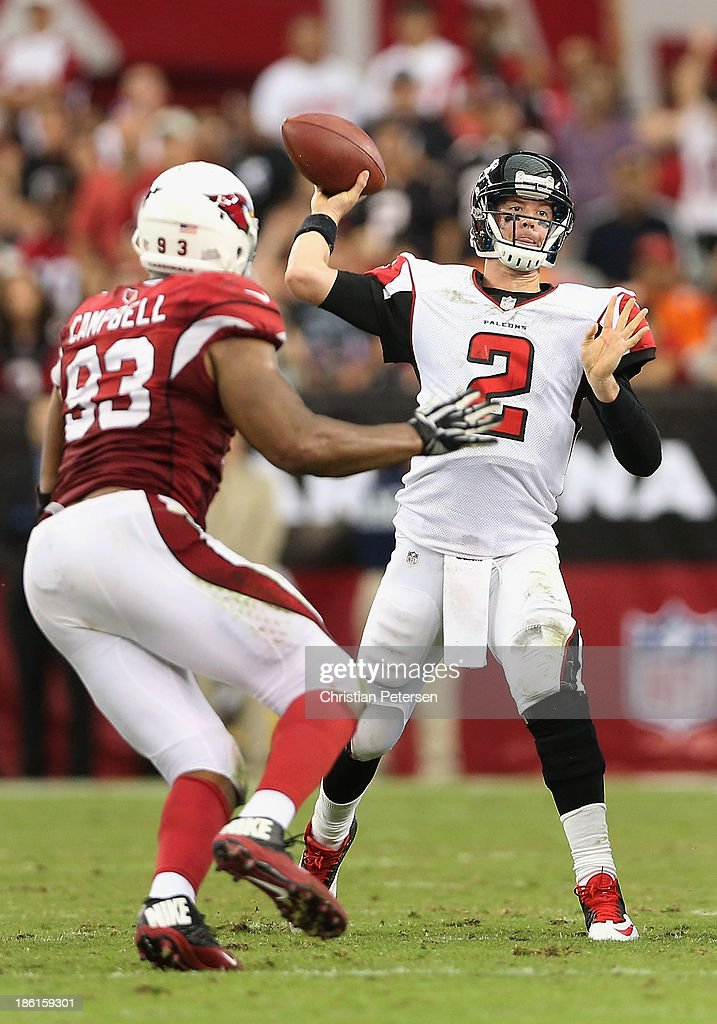 Quarterback Matt Ryan #2 of the Atlanta Falcons throws a pass over defensive end <a gi-track='captionPersonalityLinkClicked' href=/galleries/search?phrase=Calais+Campbell&family=editorial&specificpeople=2109853 ng-click='$event.stopPropagation()'>Calais Campbell</a> #93 of the Arizona Cardinals during the NFL game at the University of Phoenix Stadium on October 27, 2013 in Glendale, Arizona. The Cardinals defeated the Falcons 27-13.
