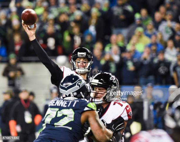 Quarterback Matt Ryan of the Atlanta Falcons throws a touchdown pass to Mohamed Sanu in the first quarter of the game against the Seattle Seahawks at...