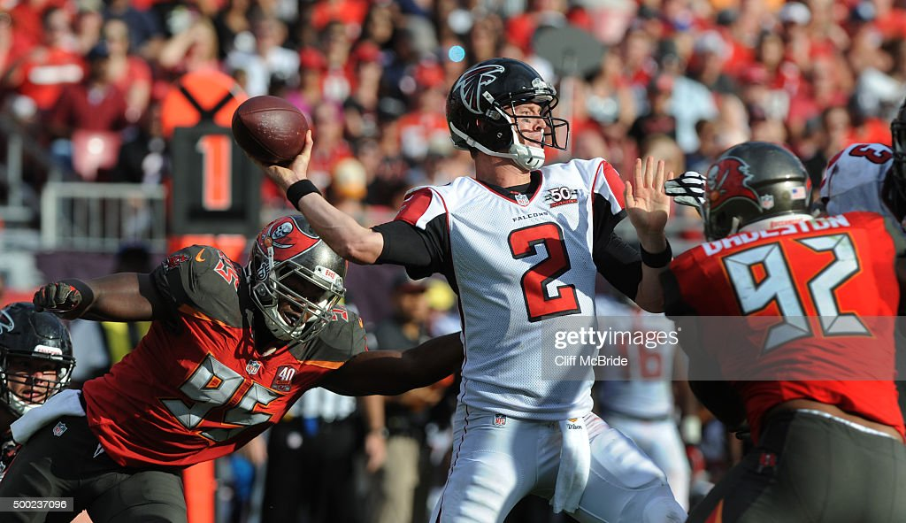 Quarterback <a gi-track='captionPersonalityLinkClicked' href=/galleries/search?phrase=Matt+Ryan+-+American+Football+Player&family=editorial&specificpeople=4951318 ng-click='$event.stopPropagation()'>Matt Ryan</a> #2 of the Atlanta Falcons throws under pressure against the Tampa Bay Buccaneers defense in the fourth quarter at Raymond James Stadium on December 6, 2015 in Tampa, Florida.