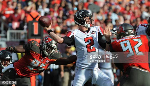 Quarterback Matt Ryan of the Atlanta Falcons throws under pressure against the Tampa Bay Buccaneers defense in the fourth quarter at Raymond James...
