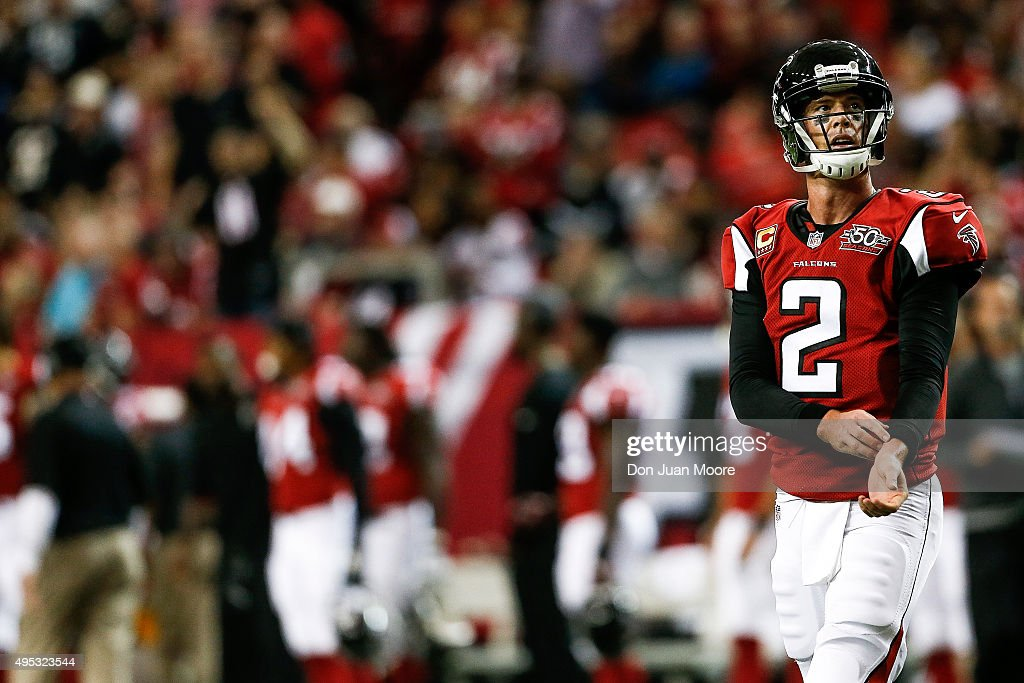 Quarterback <a gi-track='captionPersonalityLinkClicked' href=/galleries/search?phrase=Matt+Ryan+-+Footballspieler&family=editorial&specificpeople=4951318 ng-click='$event.stopPropagation()'>Matt Ryan</a> #2 of the Atlanta Falcons walks back to the huddle during the game against the Tampa Bay Buccaneers at the Georgia Dome on November 1, 2015 in Atlanta, Georgia. The Buccaneers defeated the Falcons 23 to 20 in OT.