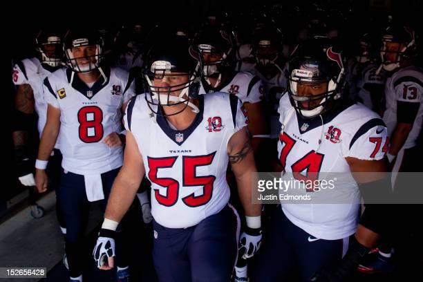 Quarterback Matt Schaub center Chris Myers and offensive guard Wade Smith of the Houston Texans prepare to lead the team onto the field before taking...