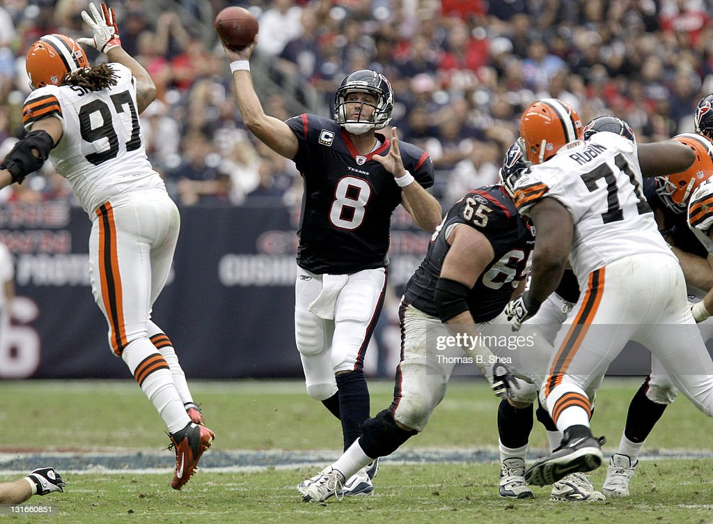 Quarterback <a gi-track='captionPersonalityLinkClicked' href=/galleries/search?phrase=Matt+Schaub&family=editorial&specificpeople=2210847 ng-click='$event.stopPropagation()'>Matt Schaub</a> #8 of the Houston Texans completes a pass against the Cleveland Browns on November 6, 2011 at Reliant Stadium in Houston, Texas.