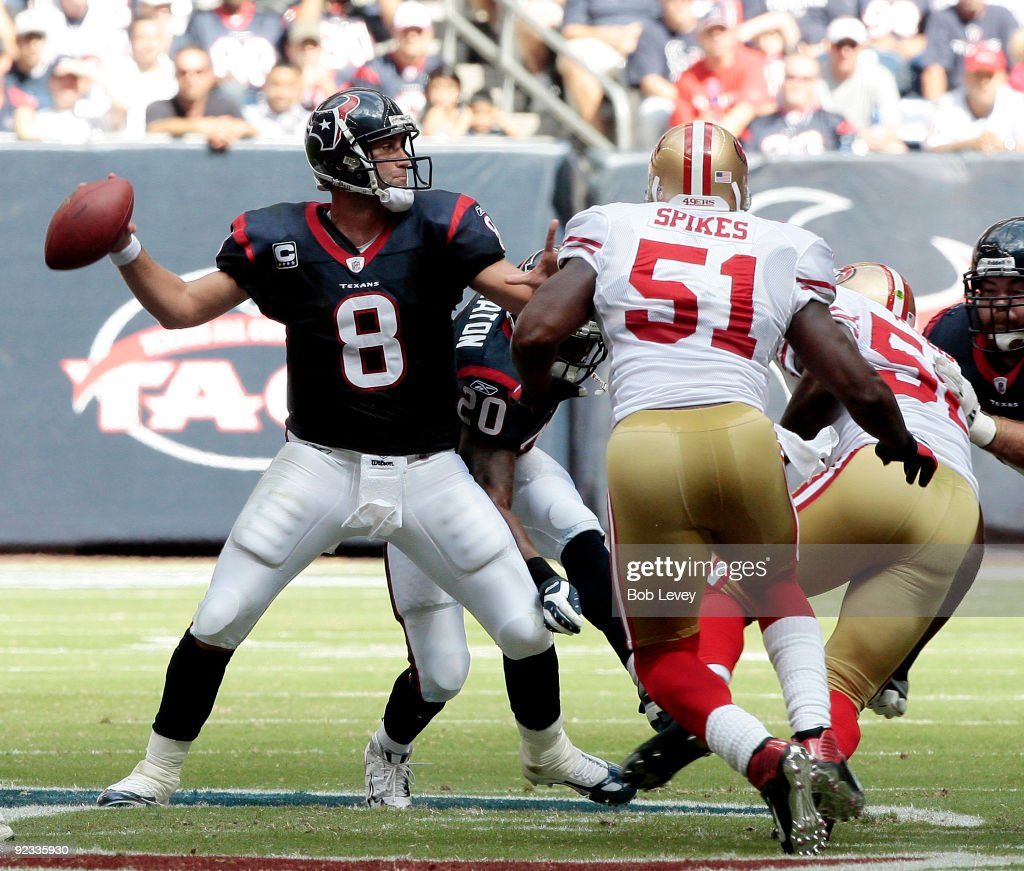 Quarterback <a gi-track='captionPersonalityLinkClicked' href=/galleries/search?phrase=Matt+Schaub&family=editorial&specificpeople=2210847 ng-click='$event.stopPropagation()'>Matt Schaub</a> #8 of the Houston Texans looks downfield for a receiver as linebacker <a gi-track='captionPersonalityLinkClicked' href=/galleries/search?phrase=Takeo+Spikes&family=editorial&specificpeople=209233 ng-click='$event.stopPropagation()'>Takeo Spikes</a> #51 of the San Francisco 49ers applies pressure at Reliant Stadium on October 25, 2009 in Houston, Texas.