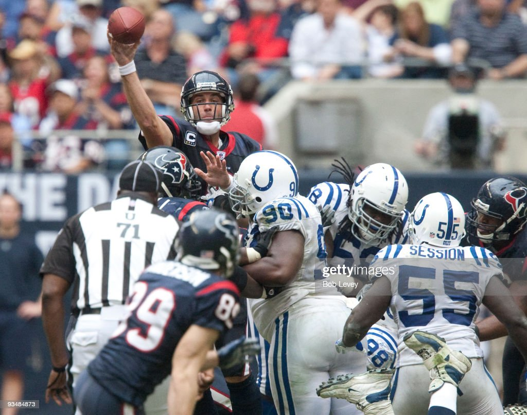 Quarterback <a gi-track='captionPersonalityLinkClicked' href=/galleries/search?phrase=Matt+Schaub&family=editorial&specificpeople=2210847 ng-click='$event.stopPropagation()'>Matt Schaub</a> #8 of the Houston Texans passes over traffic down-field in the fourth quarter against the Indianapolis Colts at Reliant Stadium on November 29, 2009 in Houston, Texas.
