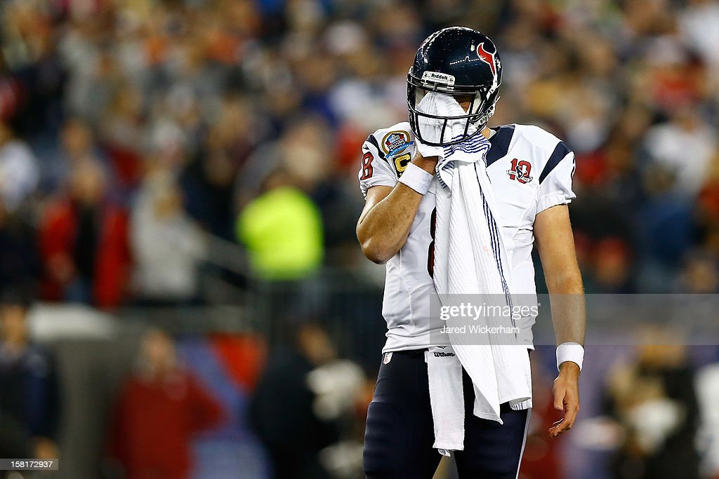 Quarterback Matt Schaub #8 of the Houston Texans wipes his face in the first half while taking on the New England Patriots at Gillette Stadium on December 10, 2012 in Foxboro, Massachusetts.