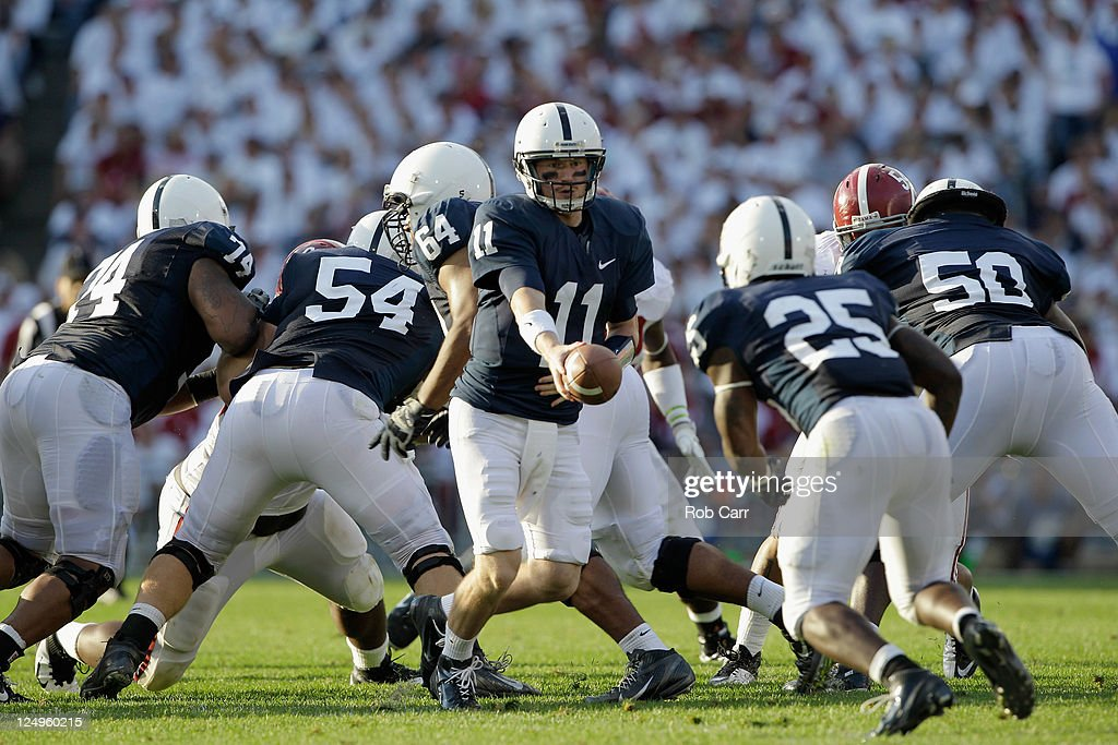 Quarterback Matthew McGloin of the Penn State Nittany Lions hands the ball off to running back Silas Redd during the first half against the Alabama...