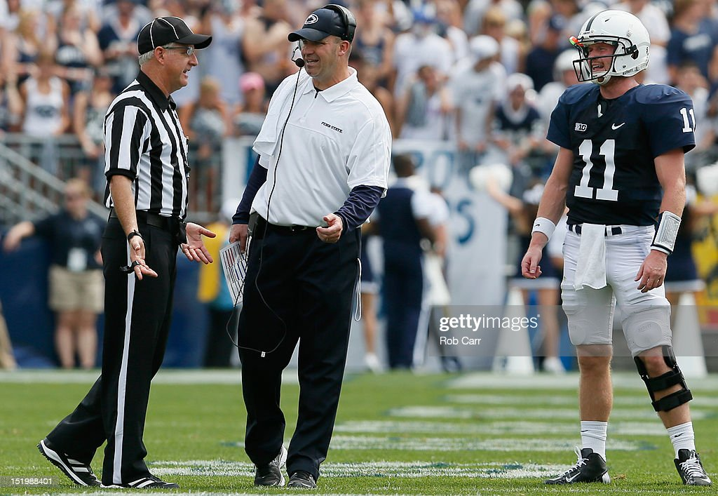 Quarterback Matthew McGloin #11 of the Penn State Nittany Lions looks on as head coach Bill O'Brien talks with an official during the second half against the Ohio Bobcats at Beaver Stadium on September 1, 2012 in State College, Pennsylvania.