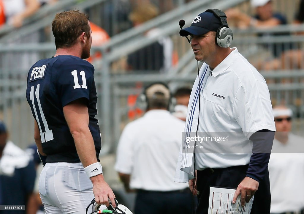 Quarterback Matthew McGloin #11 of the Penn State Nittany Lions talks with head coach Bill O'Brien during the first half at Beaver Stadium on September 1, 2012 in State College, Pennsylvania.