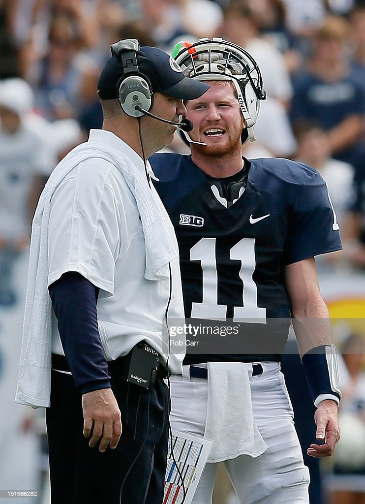 Quarterback Matthew McGloin #11 of the Penn State Nittany Lions talks with head coach Bill O'Brien during the second half at Beaver Stadium on September 1, 2012 in State College, Pennsylvania.