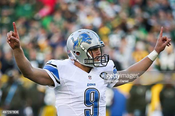 Quarterback Matthew Stafford of the Detroit Lions celebrates after Lance Moore scored a touchdown in the fourth quarter against the Green Bay Packers...
