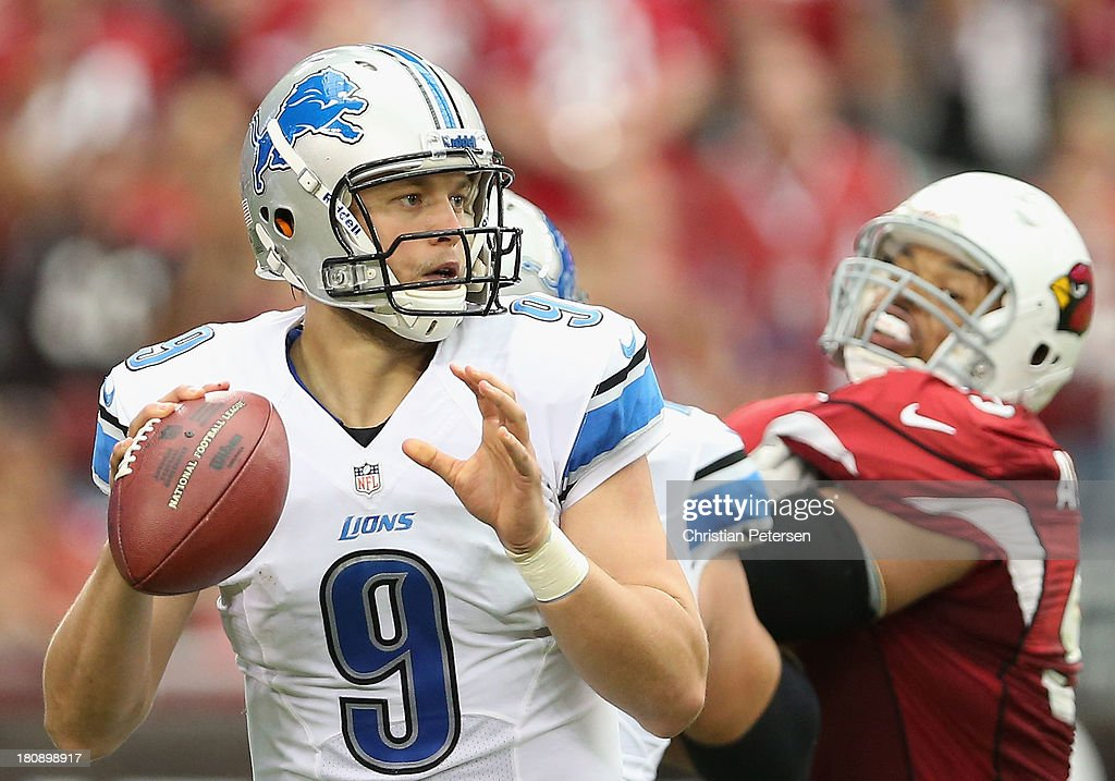 Quarterback <a gi-track='captionPersonalityLinkClicked' href=/galleries/search?phrase=Matthew+Stafford&family=editorial&specificpeople=3228634 ng-click='$event.stopPropagation()'>Matthew Stafford</a> #9 of the Detroit Lions drops back to pass during the NFL game against the Arizona Cardinals at the University of Phoenix Stadium on September 15, 2013 in Glendale, Arizona. The Carindals defeated the Lions 25-21.