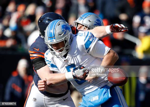 Quarterback Matthew Stafford of the Detroit Lions fumbles the football as he is sacked by Nick Kwiatkoski of the Chicago Bears in the first quarter...