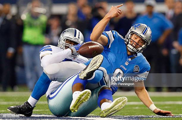 Quarterback Matthew Stafford of the Detroit Lions fumbles the ball after being sacked by defensive end Demarcus Lawrence of the Dallas Cowboys in the...