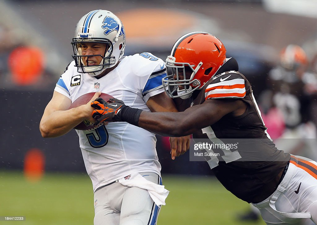 Quarterback Matthew Stafford of the Detroit Lions is hit by linebacker Barkevious Mingo of the Cleveland Browns at FirstEnergy Stadium on October 13...