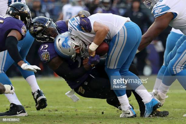 Quarterback Matthew Stafford of the Detroit Lions is sacked by outside linebacker Terrell Suggs of the Baltimore Ravens in the fourth quarter at MT...
